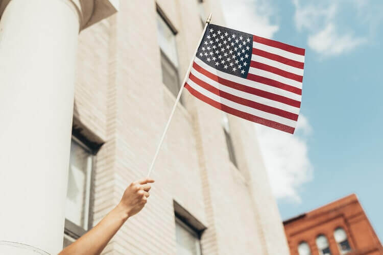A person waving the American flag